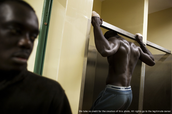 Bari, Italy - December 19, 2012 - Detention center for immigrants. Ghanaians and Cuban immigrants  do physical exercises in a room of the detention centerPh.Giulio Piscitelli