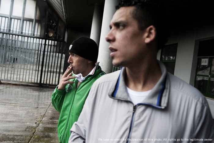 Rome, Italy - March 28, 2013 - Two Moroccan immigrants walk inside the detention center of Ponte Galeria, recently, there have been riots in the identification center in protest against low living conditions.Ph.Giulio Piscitelli