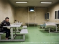 Bari, Italy - December 19, 2012 - Immigrant watching TV in a room in the detention center of Bari Palese.Ph.Giulio Piscitelli